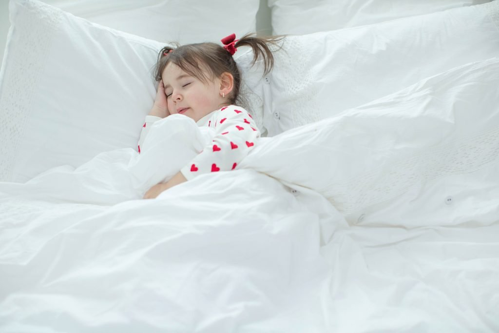 little girl sleeping in bed - Sleepyhead Consulting