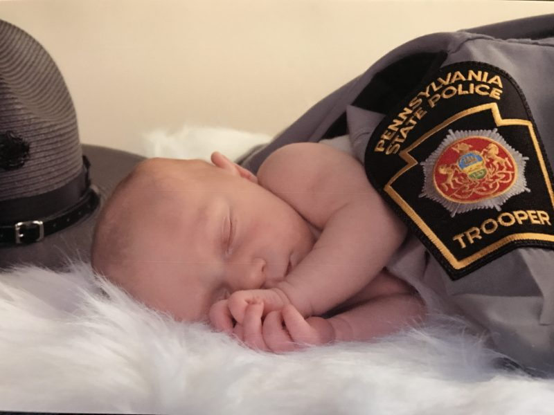 baby boy in dad's uniform - Sleepyhead Consulting