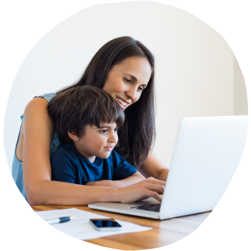 mother helping her son on a computer - Sleepyhead Consulting