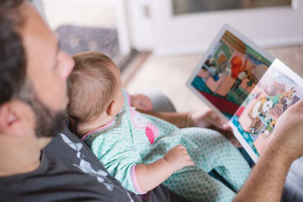 father reading to daughter - Sleepyhead Consulting
